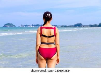 Woman shape pretty with bikini red on beach at Ban Krut Beach, Prachuap Khirikhan Province Thailand