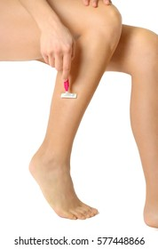 Woman is shaving her legs, isolated on white.