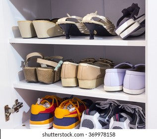 Woman shoes in the white cabinet