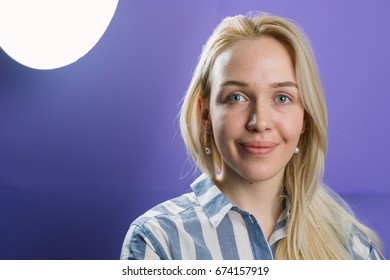 Woman shoot in the studio with purple background.