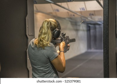 Woman Shooting at Firing Range.