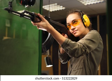 The woman at the shooting range shot from a rifle.