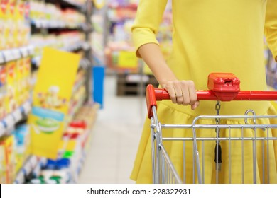 Woman shopping for baby food in supermarket