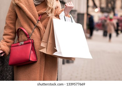 Woman with shopping bag after shopping.  Girl holding shopping bag