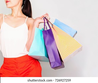 woman with a lot of shopping bags
