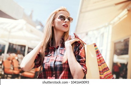 Woman in shopping. Woman with shopping bags enjoying in shopping. Consumerism, shopping, lifestyle concept