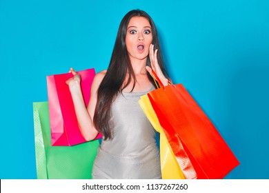 Woman with shopping bags isolated in a chroma key background