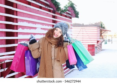 Woman with shopping bags on Christmas market