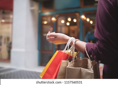 woman with shopping bags at outdoor market mall