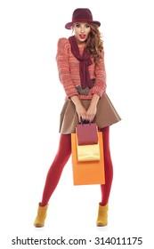woman with shopping bags. Studio shoot