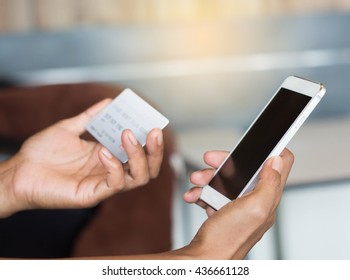 Woman shopping with a card with a smartphone.
