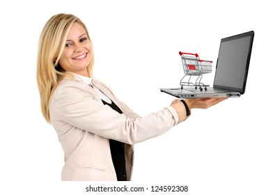Woman with shopping cart and laptop computer isolated in white