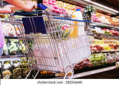 woman shopping cart in supermarket