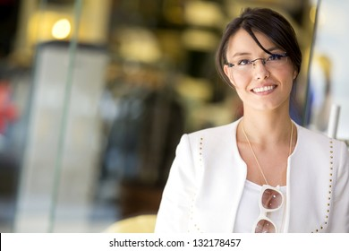 Woman at a shopping center looking very happy
