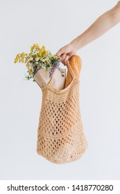 woman shopping eko style string bag mesh with products vegetables season vitamins