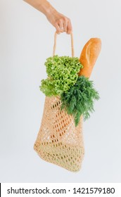 woman shopping eko style string bag with products vegetables season vitamins