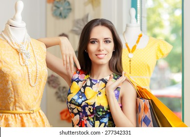 Woman Shopping in Fashion Store - Young girl shopping for yellow dresses in fashion boutique