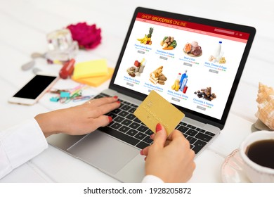 Woman shopping for groceries online and paying by credit card