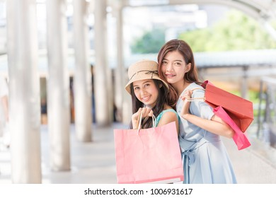 Woman in shopping. Happy woman with shopping bags enjoying in shopping.Female walks hands holding shopping bags in the city.