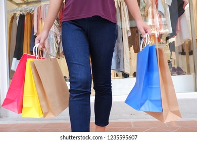 Woman in shopping. Happy woman with shopping bags enjoying in shopping