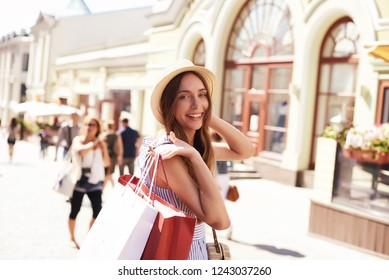 Woman in shopping. Happy woman with shopping bags enjoying in shopping. Consumerism, shopping, lifestyle concept.