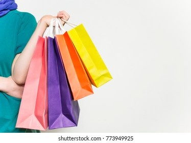 Woman in shopping. Happy girl holding shopping bags.