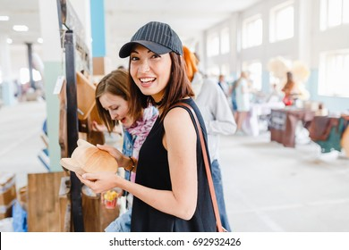 Woman shopping at the indoor handmade market