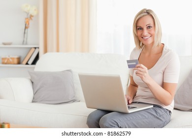 Woman shopping on line with her laptop
