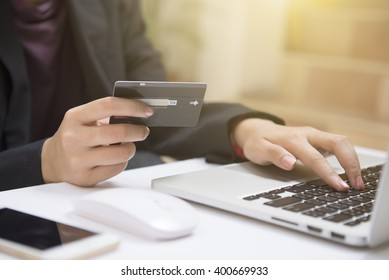 Woman shopping online Hands holding credit card and using laptop. Online shopping