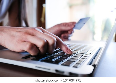 Woman shopping online with her credit card
