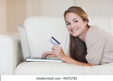 Woman shopping online in her living room