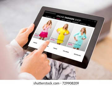 Woman shopping online for new dress.  All content is made up.