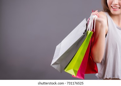 woman shopping portrait, girl shopping studio isolated, woman shopper holding shopping bag isolated girl happy satisfying shopping, good deal, sale, special offer concept; asian girl yound adult model