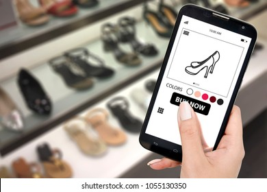 Woman shopping shoe online using smart phone select size and color the same buying as on department store