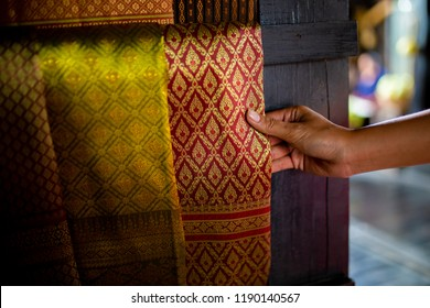 Woman shopping Thai Silk Fabric Textile at rural market.