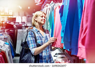 Woman shopping wear in clothing store