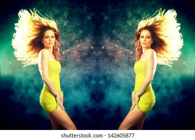 woman in short yellow dress and hair fly  dancing studio shot