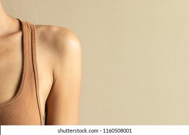 Woman shoulder. Thin body