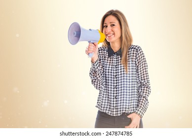 Woman shouting by megaphone