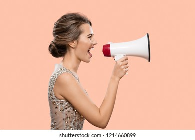 Woman shouting into a megaphone. Pink background.