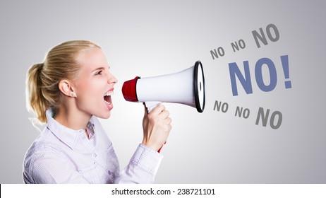 woman is shouting No through a megaphone