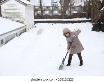 Woman shoveling snow off