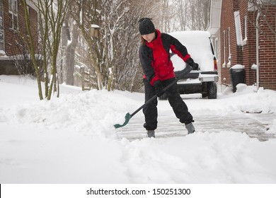Woman Shoveling Winter Snow