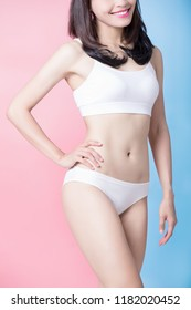 woman show her thin waist with blue and pink background
