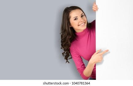 Woman show on white billboard