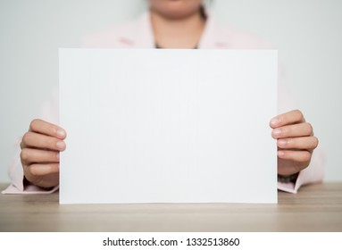 Woman showing blank white big A4 paper.Booklet design sheet display read first person. - Image