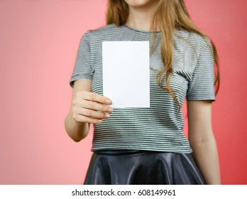 Woman showing blank white flyer paper. Leaflet presentation. Pamphlet hold hands. Girl show clear offset paper. Sheet template. Booklet design sheet display read first person.