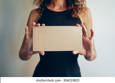woman showing a brown blank page of clipboard