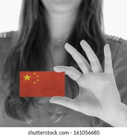 Woman showing a business card, black and white, China