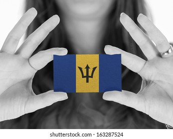 Woman showing a business card, flag of Barbados
